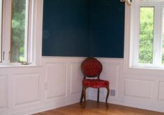 Raised panel wainscoting in a dining room.