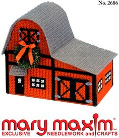 Use this pattern to make a barn from plastic canvas and yarn.