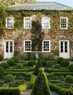 I love the rows of boxwoods and the balls of boxwoods and the cones with flippy tops!!