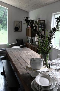 These are all rustic and vintage wood tables set in clean white minimal spaces.  The contrast creates an amazing story.    The mellow-aged wood adds warmth to the stark white spaces.