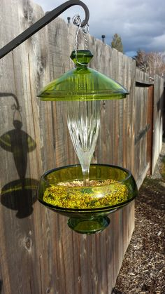 Hey, I found this really awesome Etsy listing at https://www.etsy.com/listing/177593208/green-and-clear-glass-hanging-bird
