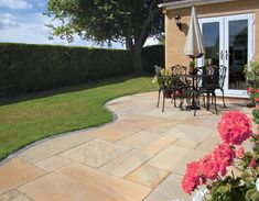 Pavestone Golden Fossil, a warm sandstone natural stone paving. Looks great with yellow brickwork such as London Brick. Sandstone Paving Slabs, Concrete Paving, Paving Stones, Flagstone, Garden Paving, Garden Stones, Garden Landscaping, London Brick, Garden Projects