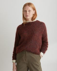 Soft, lightweight mohair/wool/cotton blend. Easy, slouchy cut. Double ribbed trim neckline. Very dropped shoulder. Ribbed cuffs and hem.