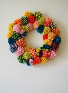 pom wreath for a festive door DIY pom pom wreath Craft Stick Crafts, Diy And Crafts, Arts And Crafts, Grandma Crafts, Pom Pom Wreath, Pom Pom Crafts, Easter Crafts For Kids, Crafty Craft, Diy Gifts