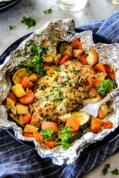 Baked or Grilled Italian Mozzarella Chicken Foil Packets bursting with juicy chicken and tender, flavorful veggies all smothered in Mozzarella Cheese!