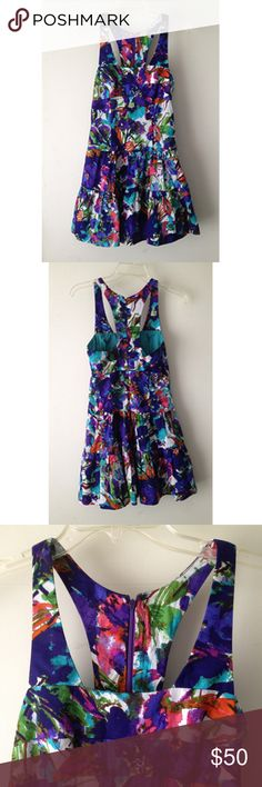 Nicole Miller Artelier Floral Dress Condition: regular wear and tear, hook-eye at top of zipper is missing hook, some loose threads Color: Purple, blue, reds floral pattern Size: Sample so no numbered size tag, fits like an S, please refer to measurements  Square neckline Racerback Fitted through waist Concealed center back zip Tiered skirt Lined  Armpit to armpit ~ 15 inches Waist ~ 14 inches Length ~ 30 inches Artelier Nicole Miller Dresses