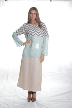 A seafoam silk gazar with linens..and silver hand of fatima patters ontop..2013 collection