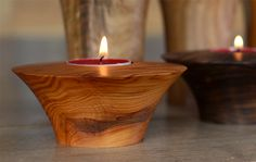 Assorted tea light holders made from walnut, elm and spalted beech - however, you can customise your selection below! Beautifully crafted to the same standard as my larger bowls and finished with lemon oil. Available in sets of three or more, the shorter round ones measure approximately 100mm diameter.