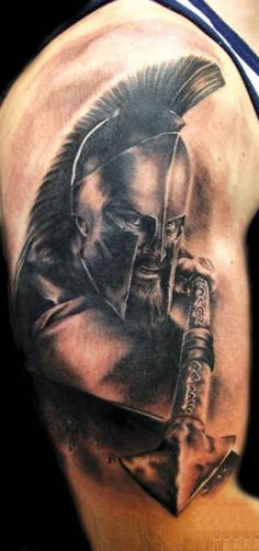 Spartan warrior with a spear tattoo                              …