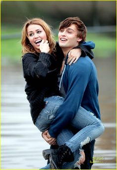 Miley Cyrus romped in the rain with LOL co-stars Ashley Greene and Douglas Booth while filming the movie in Paris on Monday. Miley, Ashley and Douglas seemed Movie Couples, Famous Couples, Cute Couples, Miley Cyrus Nick Jonas, Bae, Douglas Booth, Romance, Jonas Brothers, Funny Movies