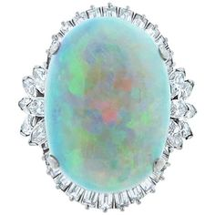 Fiery Platinum Mount Opal and Diamond Ring