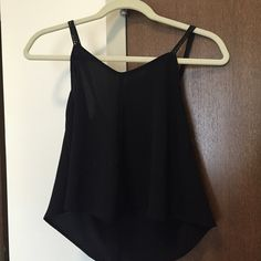 Flowy Black Crop Top Perfect tank for spring. Shows a bit of midrift. Super cute strap detail. Peppermint Tops Crop Tops