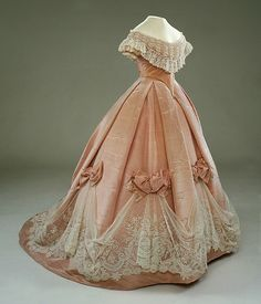 This reminds me of Disney's Cinderella dress. In the Swan's Shadow: Evening dress/ballgown, ca. 1865