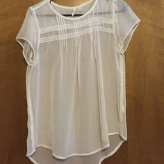 White blouse This shirt is so gorgeous. It is great for layering and is so lightweight for spring/summer. It has the prettiest details and has only been worn one time. From Nordstrom. Size medium. Frenchi Tops Blouses