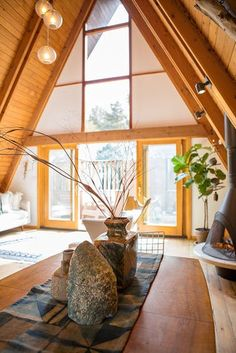 A 1963 A-frame home redesigned by Desanka, it's filled with her discerning creative touches. Her earthy style effortlessly complements the natural wood construction and brightness.