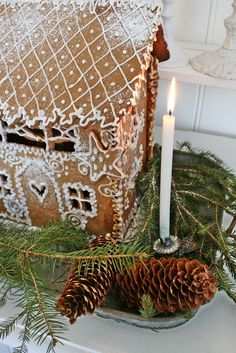 Gingerbread house, a candle, a pinecone and greenery ~ all the sweet smells of Christmas!