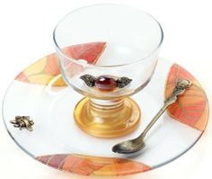Glass Rosh Hashanah Honey Dish on Stand with Leaf Motif by World of Judaica. $33.00. You will be pleasantly surprised! The vast majority of our shipments arrive within 10-14 business days from time of shipment, far in advance of Amazon's default calculation of shipping times for items shipped from Israel.. Your order includes 1 item(s).. Dimensions: 20 x 9cm. Material: Glass. This glass bowl for honey on Rosh Hashanah is decorated with a red bead and comes with a plate bear...