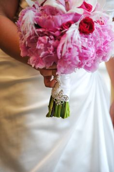 a piece of my mother's wedding dress on my bouquet with fleur de lis broach