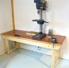 Workbench by Matthias Wandel -- Homemade workbench constructed from a surplus solid-core door, 2x4s, and 2x6 dimensional lumber. http://www.homemadetools.net/homemade-workbench-37