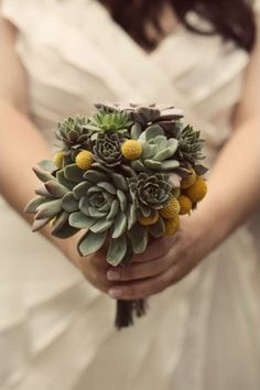 hens & chicks bouquet -- This is just adorable. And who couldn't do this themselves? What a great idea!