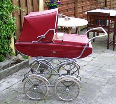 Vintage stroller for baby shower pictures.