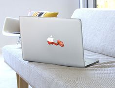 Personalize your Macbook with Bittenfruit's range of artist designed stickers.