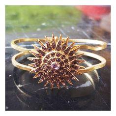 Free People sunburst bangle Gorgeous gold bangle by free people. Hinges open for easy wear. Beautiful faux diamond sunburst embellishment. Free People Jewelry Bracelets