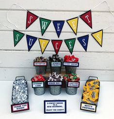 Add some fun to your graduation table by using our NEW candy signs to display on your dessert table. Our original Candy Signs were a huge hit so weve added this set of additional sayings that weve created since then. All are made on a solid black cardstock background with red, orange,