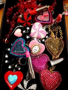 tarina tarantino  I have the red heart at bottom left.  It was a locket with mother and father's pictures.