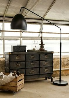 This gorgeous factory sideboard, oversized lamp and brown neutrals work so well together.