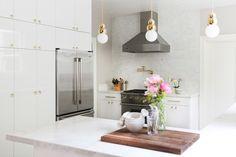 Bright, elegant white kitchen.  Storage wall, mixed metals