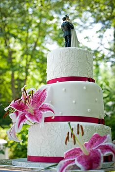 Wedding cake with pink lilies.