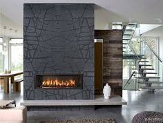 Add unique and eyecatching texture to your living room with our Natura collection. Inspired by organic forms, this fireplace features Ardesia black slate with a Sea Grass design.
