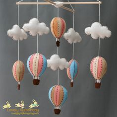 Vintage peach and blue baby mobile -- I have been thinking about making something similar, but not sure I could equal this...
