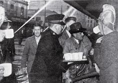 Photograph - A Salvation Army worker provides tea for firemen and volunteers battling the fire , Christchurch City Libraries Heritage Photograph Collection Christchurch New Zealand, City Library, Firemen, Volunteers, Battle, Army, Tea, Firefighters, High Tea