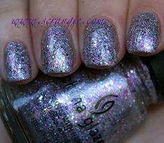 China Glaze Full Spectrum. China Glaze's description: Baby pink bursts into holographic magenta to party with silver, gold, blue, pink and green particles.
