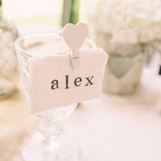 white heart pegs wedding place card holders