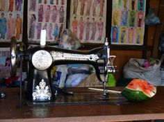 A lovely sewing machine with some great fashion posters in the background.
