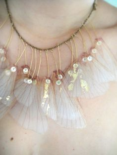 "how to make?? -Try ""silk"" flower petals, painted veins, sequins wire wrapping... necklace? Not wire... lest it's cloth wrapped..?"