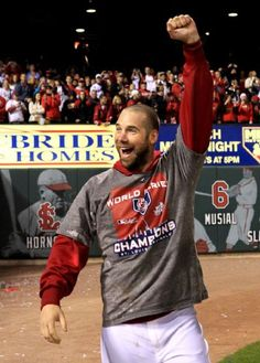 Chris Carpenter celebrates on the field with the fans after the St. Louis Cardinals clinched the World Series between the Texas Rangers and St. Louis Cardinals at Busch Stadium on Friday October 28, 2011 in St. Louis.