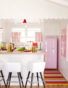 """{A Bright and Bold Summer Beach House}  How About That Pink Fridge?  A pink Smeg refrigerator from Sears is the showstopper in the guest-suite kitchen. Lina rug from Plastica. """"How about that pink fridge? Isn't it great? It's tiny — perfect for a small kitchen."""""""