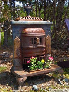 Using a broken oven or stove range as a planter is a nice way to recycle and save money on expensive flower pots