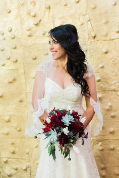 bride with red and succulent bouquet  at the Millwick in downtown Los Angeles by LA wedding photographer Loie Photography