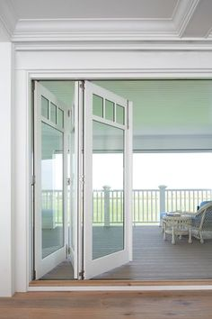 The dark roof grey weatherboard white framing is great for Marvin bi fold doors