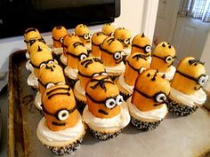 Despicable Me Cupcakes--Easy Minions made with half a Twinkie, some black frosting to make the face and Smarties candies for the eyes.  I would use bright blue frosting instead of white to make them more Minion-looking.  Love the different hairdos and expressions made with the black frosting.