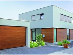 Garagepoort • hout • moderne woning • www.hormann.be # livios.be