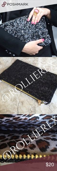 Jet Black Sequined Clutch New in package. So classy! Outside is covered in sequins and inside cheetah print. Excellent piece to add to a dinner date and roomy to hold all your necessities   ▫️Material: polyester  ▫️Length: 21cm ▫️Width: 28.5cm  ⭐️⭐️⭐️⭐️⭐️ 5 star rated item    ⬛️ Posh Ambassador ◾️ 600+ Sales  🔳 No Trades Bags Clutches & Wristlets