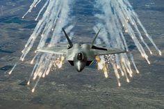 Lockheed Martin F-22 Raptor launching flares.