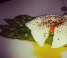 Steamed asparagus topped with a poached egg. A simple and healthy meal that you can have for breakfast, lunch or dinner.