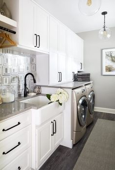 Caesarstone Symphony Grey countertops in this large laundry room with white shaker cabinets. Laundry Room Colors, Large Laundry Rooms, Laundry Room Design, Kitchen Design, Sink Design, Kitchen Ideas, Laundry Room Cabinets, Basement Laundry, Kitchen Cabinets
